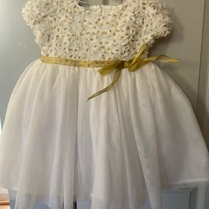 White and gold toddler dress.
